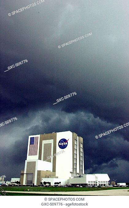 06/18/2002 - Dark, rain-filled clouds blanket the sky over the Vehicle Assembly Building and Launch Control Center, bringing thunder and heavy rain to the area