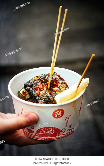 Changsha, Hunan province, China - A bowl of delicious stinky tofu with pickles