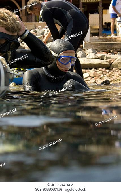 Sara Campbell entering the water to begin her warm up before her world record attempt at the constant weight freediving discipline, June 2009 Blue Hole Dahab