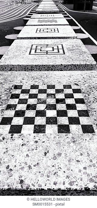 Chessboard and line of games tables, Superkilen, Norrebro, Copenhagen, Denmark Scandinavia. Superkilen is an urban development designed to celebrate diversity...