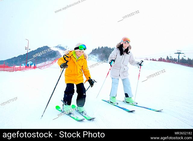 Happy mother and child in the ski resort