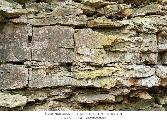 natural outdoor photography of a brittle layered rock formation