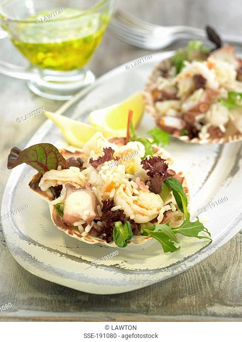 Rice,shrimp,scallop,octopus,and monkfish salad served in scallop shells