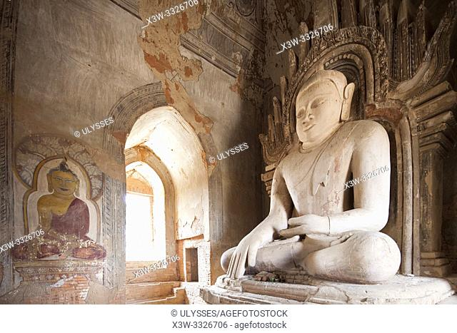 Buddha statue and paintings in a temple near Alotawpyae temple, Old Bagan and Nyaung U village area, Mandalay region, Myanmar, Asia