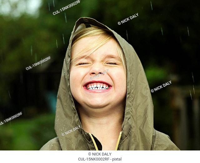 Girl smiling while it rains
