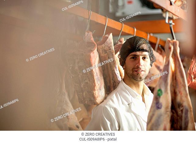 Portrait of butcher wearing hairnet