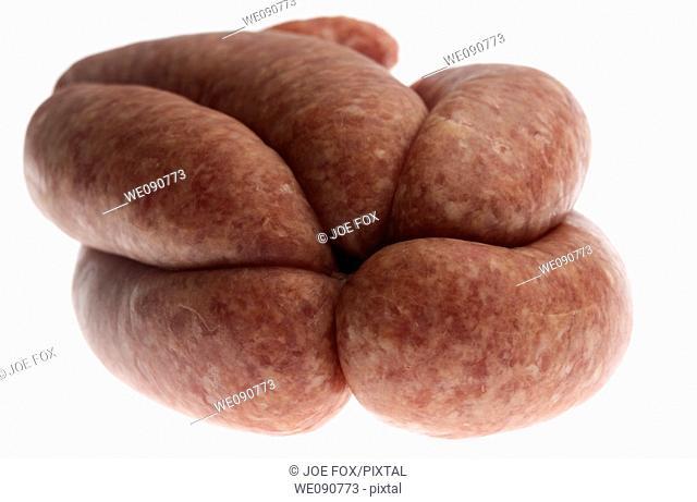raw links of pork sausage from organic british saddleback pigs reared in ireland