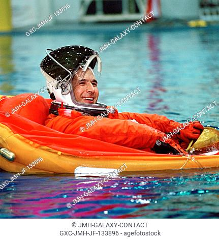 Astronaut John B. Herrington, STS-113 mission specialist, floats in a small life raft during an emergency egress training session in the Neutral Buoyancy...