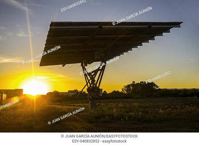 Urban photovoltaic panel with solar tracker placed outdoors building