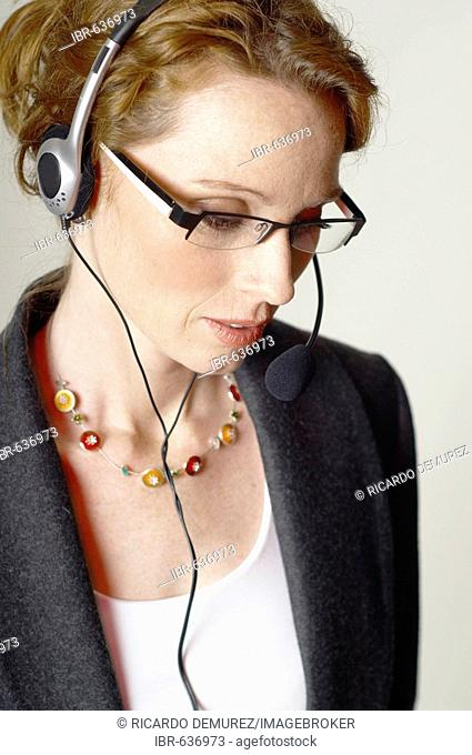 Businesswoman wearing eyeglasses and headset