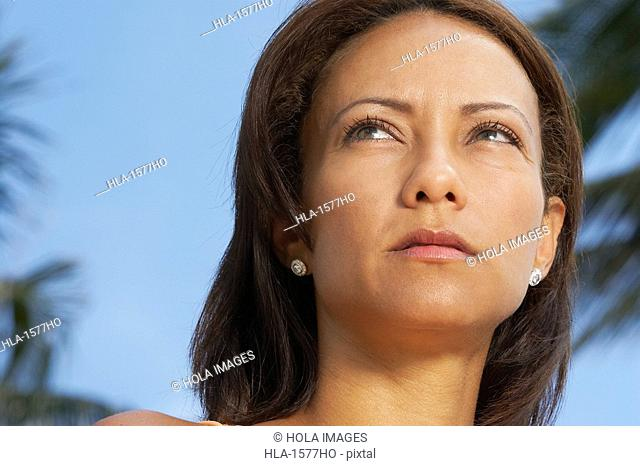 Close-up of a mature woman thinking