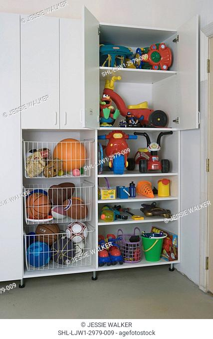 GARAGE STORAGE: clean and organized after pictures, storage cabinet detail, wire pull out bins filled with balls, open doors on cabinet to reveal toys