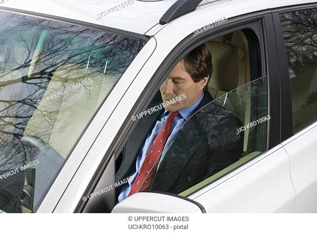 Businessman driving to work