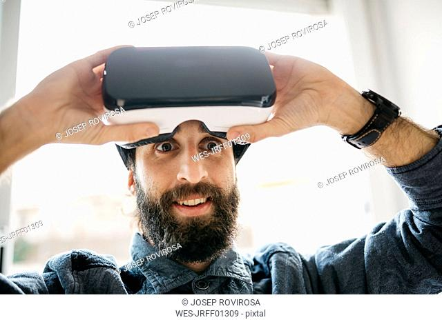 Portrait of starring man with Virtual Reality Glasses