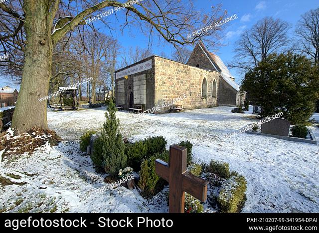 26 January 2021, Brandenburg, Birkholz: The church in the Bernau district of Birkholz is considered to be one of the oldest fieldstone churches in the Barnim...