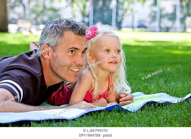 father and young daughter spending quality time together in a park, edmonton alberta canada