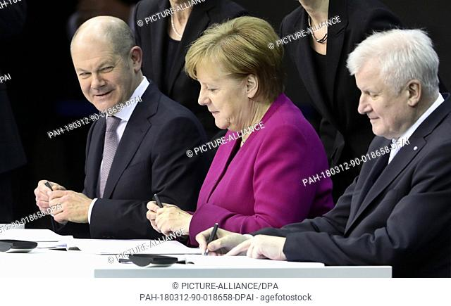 12 March 2018, Germany, Berlin: German Chancellor Angela Merkel of the Christian Democratic Union (CDU), interim chairman of the Social Democratic Party (SPD)...