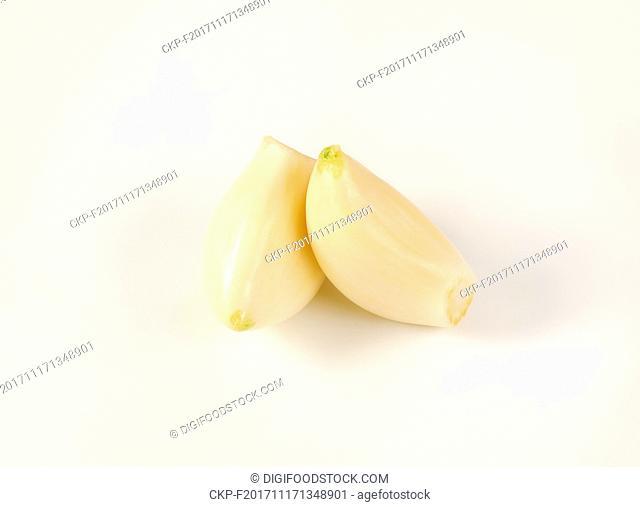 peeled cloves of fresh garlic on white background