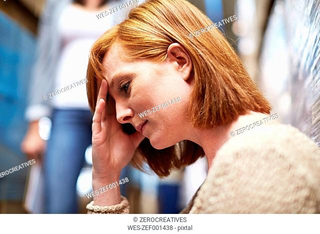 Pensive redheaded woman