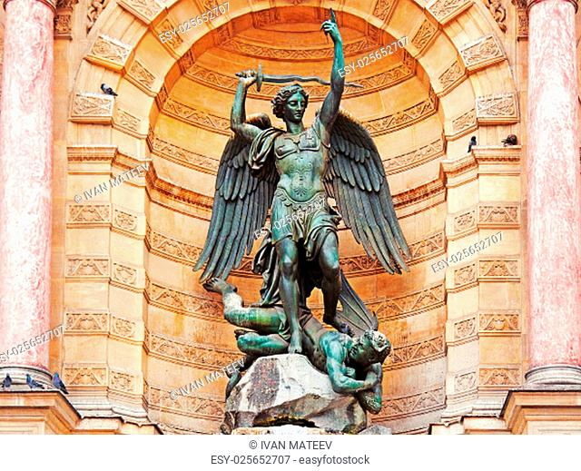 The statue of Saint Michael atop the fountain in the Place Saint-Michel at the northern end of the Boulevard Saint-Michel