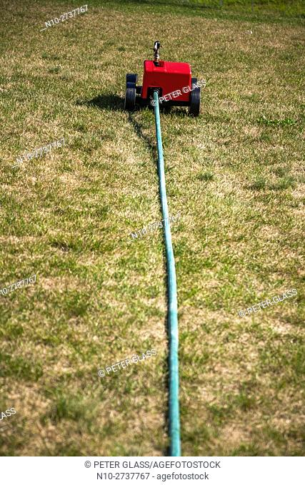 Device on a large lawn