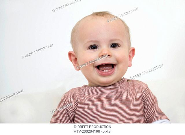 Portrait of laughing toddler