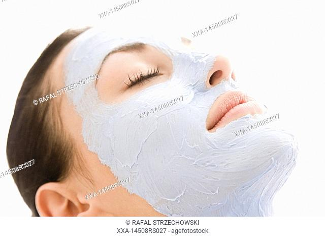 woman with blue facial mask