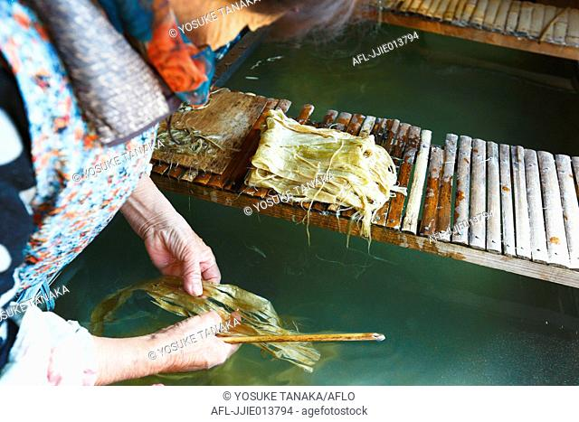 Japanese traditional paper craftsman working in her studio