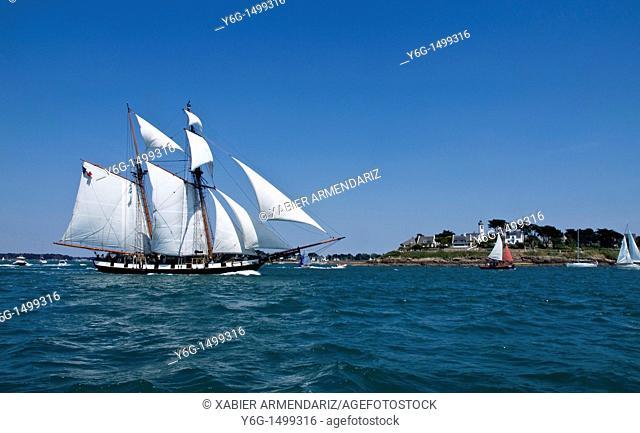 Ancient schooner sailing near a lighthouse, Bay of Morbihan, Birttany, France, Europe