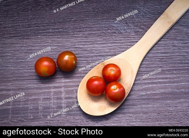 Cherry tomatoes in a wooden spoon