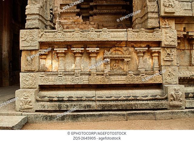 Carvings on the right side of the plinth. North Gopura of the inner courtyard, Achyuta Raya temple, Hampi, Karnataka, India. Sacred Center