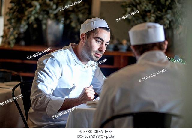 Chefs chatting in restaurant