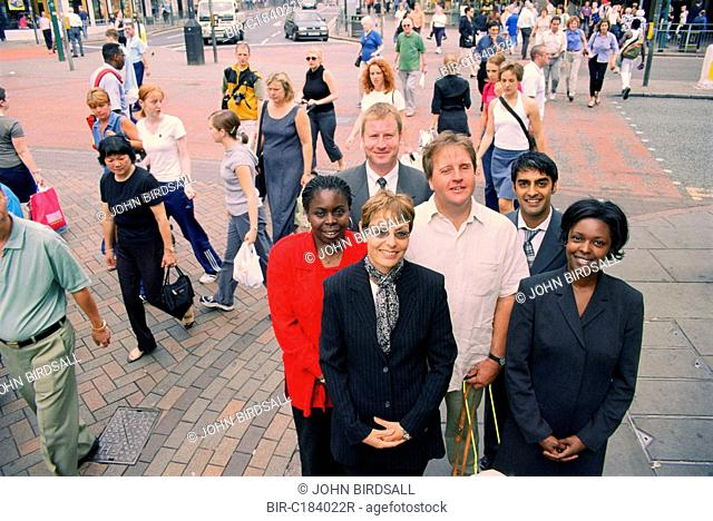 Multiracial group of adults standing together in street
