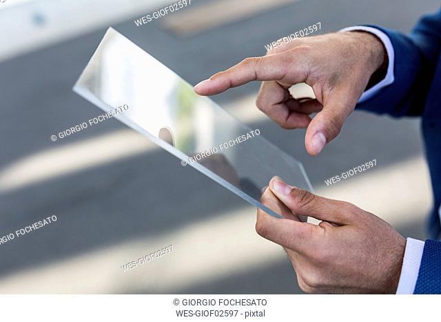 Close-up of businessman using futuristic portable device