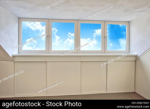 Fresh white modern dormer window with blue sky and white clouds view, New dormer, roof window in empty new house closeup