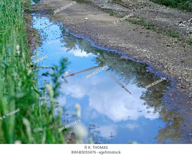 windpark Parndorf, Austria, reflection of a wind wheel in a puddle