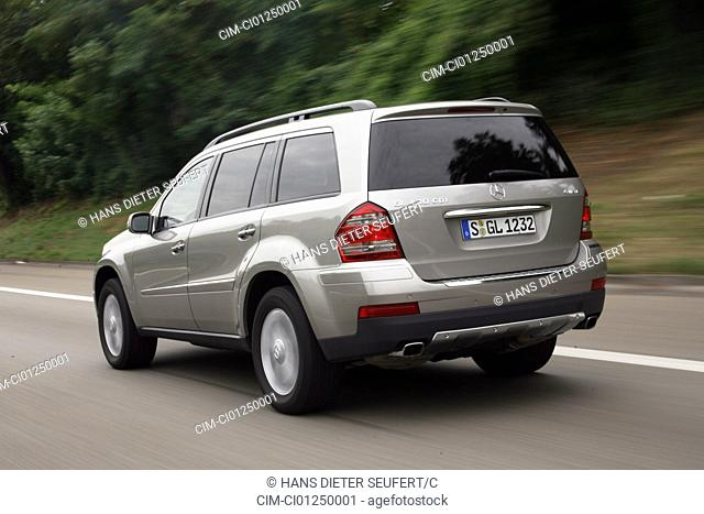 Mercedes GL 420 CDI, model year 2006-, silver, driving, diagonal from the back, rear view, country road