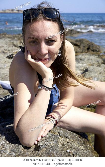 portrait of woman at seaside. Crete, Greece