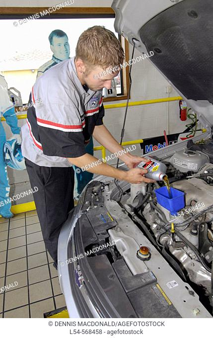 Quick oil change garage where drive in customers have oil changed in minutes or while you wait