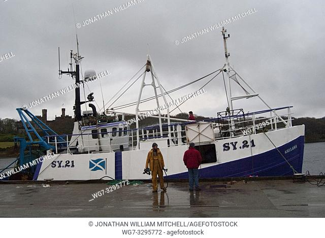 UK SSCOTLAND -- 04 Nov 2010 -- Fishermen bring in their fishing boat the KAYLANA into the harbour at Stornoway on the Isle of Lewis in the Outer Hebrides of...
