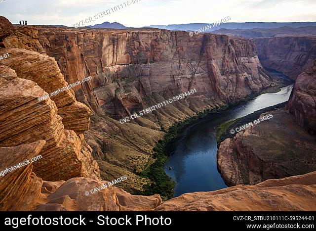 Hikers at Horseshoe Bend, part of the Colorado River near Page, AZ