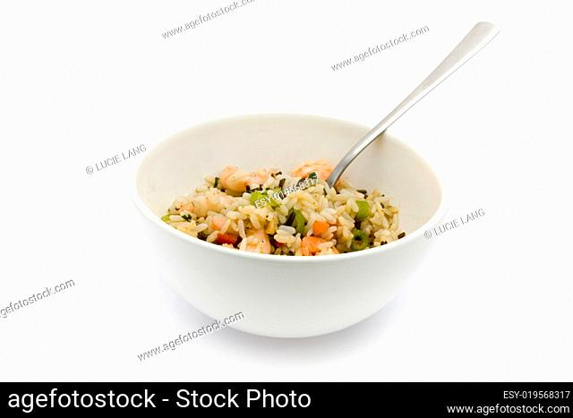 Thai prawn and rice dish ith fork over white