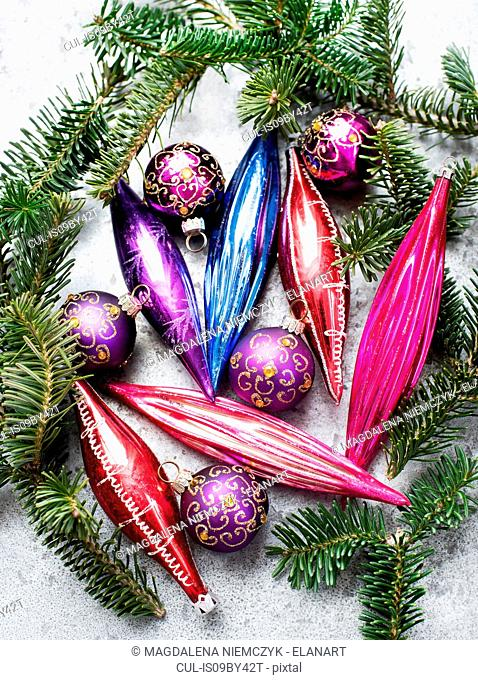 Colourful vintage glass bulbs with twig of Christmas tree
