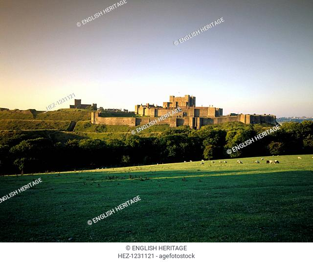 Dover Castle, Kent, viewed from the north-east, illuminated by early morning sunlight, 1996. An earlier earthen castle was rebuilt in stone in the 1180s