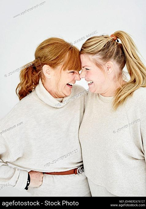 Mother with adult daughter, studio shot