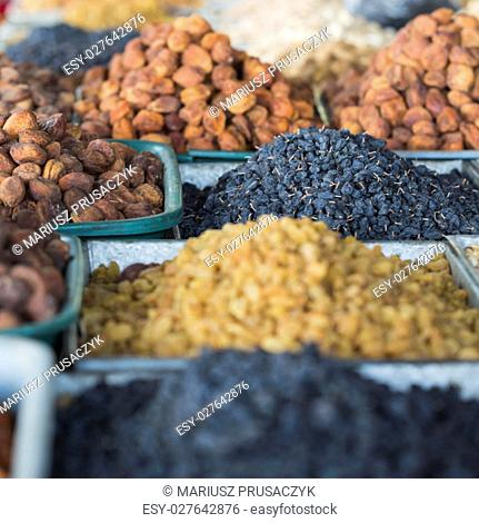 Dry fruits and spices like cashews, raisins, cloves, anise, etc. on display for sale in a bazaar in Osh Kyrgyzstan