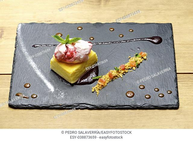 Cheesecake with red fruit and ice cream