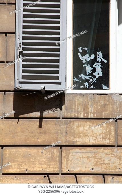 adhesive stickers on child's bedroom window in rome italy