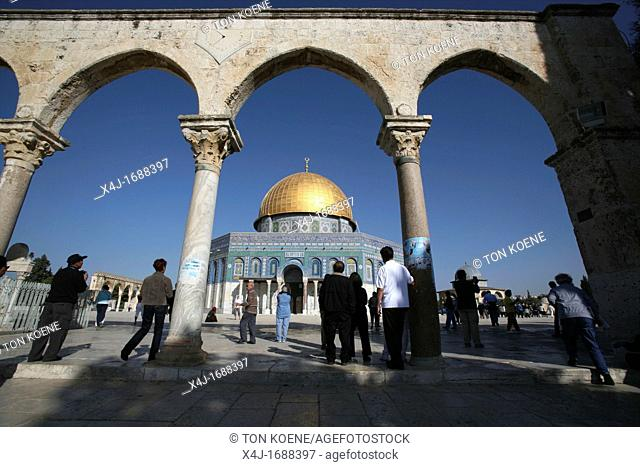 The Dome of the Rock on Temple Mount in the Old City of Jerusalem as seen from ancient arches