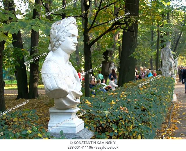 Antique sculpture in autumn